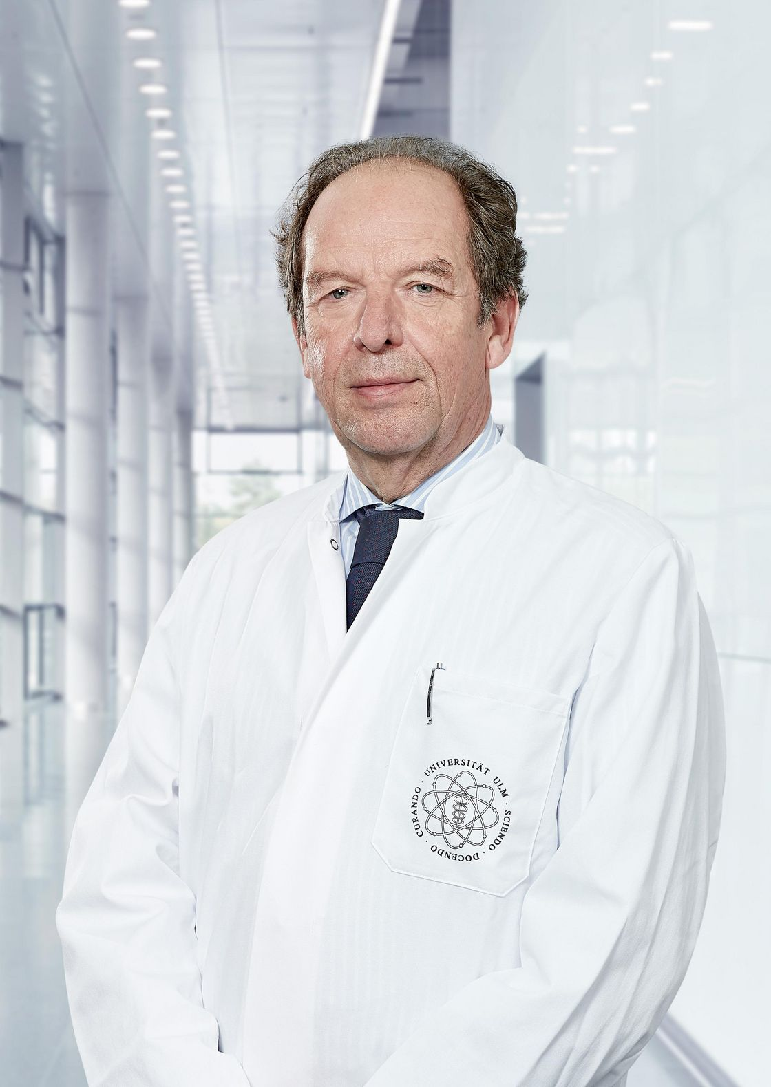 Photo of Prof. Klaus-Michael Debatin standing in a corridor of the hospital