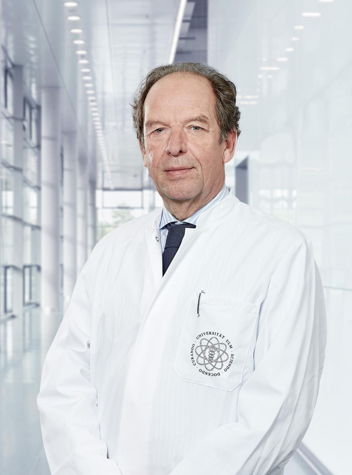 Photo of Prof. Lüder-Hinrich Meyer standing in a corridor of the hospital